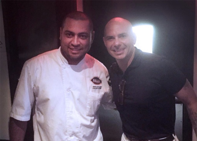 New Photos: Pitbull with fans at Bulla Restaurant in Miami.